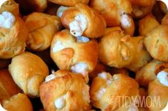 Cream cheese, chicken, garlic powder, and crescent rolls. Finger food goodness.