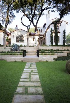 White home with Spanish/Mediterranean flair - Large landscaped front yard - Ryan Street & Associates