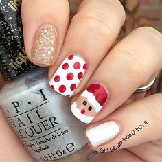 11.Purple Glitter and White Winter Pattern Glitter is perfect for Christmas. These next nails feature a purple glitter shade. There are also two accent nails with a cute winter pattern. You could recreate something similar or create something unique by adding your own shapes. Maybe even try a different glitter shade to. 12.Cute Gift Nail …