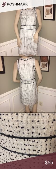 Michael Kors Sz. 8 Dress Such a gorgeous dress!!! A white woven blend dress that is lined and fitted, it has navy blue and cream threads woven through the dress. It has a navy blue leather-like piping. Very attractive and slimming fit. Michael Kors Dresses Midi