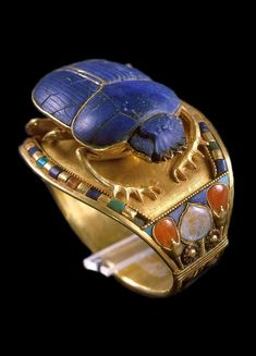 Scarab bracelet of Tutankhamun The small circumference of this bracelet suggests that it was made for Tutankhamun when he was a child. This scarab bracelet is made of gold, lapis-lazuli, carnelian,. Ancient Egyptian Jewelry, Egyptian Scarab, Egyptian Queen, Egyptian Tattoo, Egyptian Mythology, Egyptian Goddess, Egyptian Symbols, Collier Antique, Egypt Jewelry