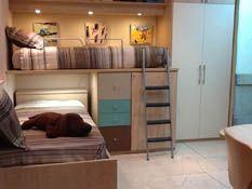 R219 - Juvenil compacto de dos camas con cajones y armario con puente.