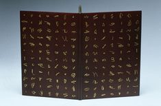 A Satyr Against Mankind by The Earl of Rochester bound by Tracey Rowledge // bound in chestnut brown goatskin with gold tooled designs