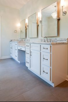 Three mirrors line a wall in this spacious bathroom. Cobblestone Bathroom, LM9. Follow the link for the full home photo gallery.