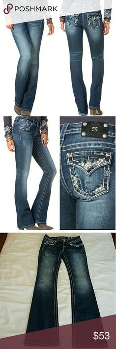 """Miss Me Pyramid Stud Border Midsize Boot Cut Jeans NWOT Miss Me Pyramid Stud Border Midsize Boot cut Jeans.Jeans have been washed once but have never been worn.Medium-dark wash with fading, whiskering and distressing. Detailed with an embellished design on front and back pockets.PLEASE NOTE these jeans are distressed so the rips that you see in the pictures were there from the beginning and not a sign of wear.That includes the rips on the bottom edge of the legs.Size 26. Waist 14""""1/2 lying…"""