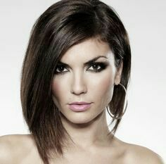 Loving the asymmetrical bob with a side parting..especially with dark brown hair