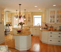 Kitchen in West Chester, PA. Designed by Chester County Kitchen Bath in West Chester, PA. Fieldstone Cabinetry Stratford door style in Maple finished in Ivory Cream.