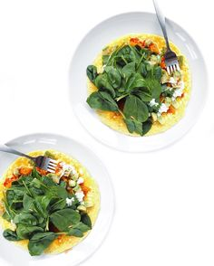 Open-faced spinach omelette with cherry tomatoes onion avocado goat ...