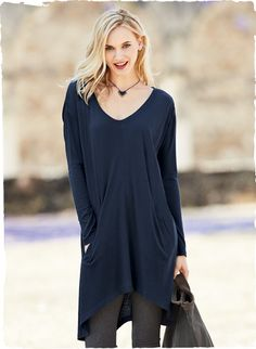 Minimalism at its laid-back best, this relaxed tunic-dress in lightweight pima (51%) and modal (49%) jersey  has a wide open v-neck, drop shoulders, pockets and a curving asymmetrical hem. Layer over tanks or leggings for a cozy, transitional wardrobe addition.