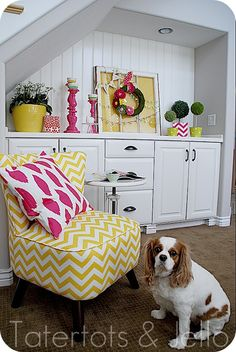 I love this happy little corner, and I absolutely NEED to recover my chair in a bright yellow chevron print.  Or bright pink...
