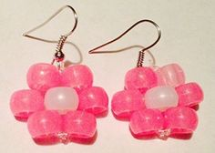 MoonlitShop Single Glow in the Dark Pink Flowers with Pearl White Middle Kandi Earrings MoonlitShop http://www.amazon.com/dp/B00M6AOF0I/ref=cm_sw_r_pi_dp_0Jv1tb0K7G5DW8P0