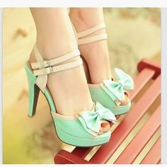 Mint green pastel shoes with bow. Would get a pedi just to rock these in the summer.