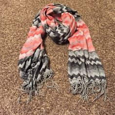 Chevron scarf. Chevron Scarf. Super cute! Has oranges, and greys in it. Chevron all over pattern with fringe on the edges. It is thick material. Keeps you warm! Accessories Scarves & Wraps