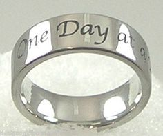 Stainless Steel One Day at a Time Band Ring SZ 5-12 AA Recovery   Whether you or someone you love are having hard times, or you just want to remind yourself to live each day as it comes, this ring is the perfect declaration of this sentiment.