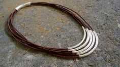 Sterling silver  on multiple strands of leather Necklace/ Layered Chic