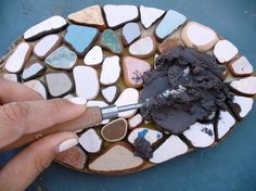 Making a mosaic trivet step 3b filling gaps with grout