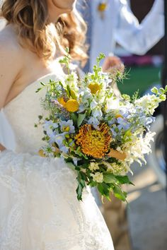 baby blue and orange florals mixed with other greenery for bouquet #bouquet #bride #weddingchicks http://www.weddingchicks.com/2014/01/22/classy-country-wedding/