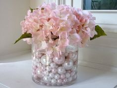 Inexpensive idea for a wedding table decoration. Pearls on bottom with flowers on top. Tea candles on mirrors Pearl Wedding Centerpieces, Pearl Centerpiece, Bridal Shower Centerpieces, Candle Centerpieces, Wedding Table Centerpieces, Floral Centerpieces, Flower Arrangements, Wedding Decorations, Decor Wedding
