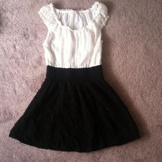Black and White Free People Dress Super cute mini dress. Sheer white top with black lace bottom. Stretch waist band, side zipper. Fits like a 0/small Free People Dresses
