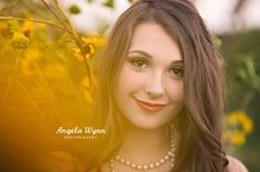 This is my first senior with sunflowers! I guess these beauties decided to take root for the first time this year at this location. Totally in love with the feel of this part of Alyse's senior session. Check back for the other outfits from her shoot these next few days.