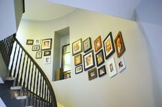 gallery wall on curved stairs