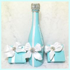 """Angela's Fantasy Creations on Instagram: """"The @tiffanyandco inspired Memory Bottle we created with matching #favorboxes for @storybook_bliss photo shoot! #tiffanyandco #breakfastattiffanys #tiffanyblue #whitebow #bow #bottle #champagnebottle #favor #favors #AFCmemorybottle #tiffannys #blingbottle #blingbottles #brandbottle #champagebar #weddingbottle #weddingchampagne #babyshower #bridalShower #classy #beverlyhills #kocktailswithkhloe"""""""
