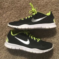 Nike sneakers Black with neon yellow. Size 9 true to size. Good used condition/wore one season! Nike Shoes Sneakers