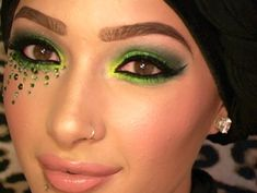 Vibrant chartreuse eye shadow with rays of crystal accents.