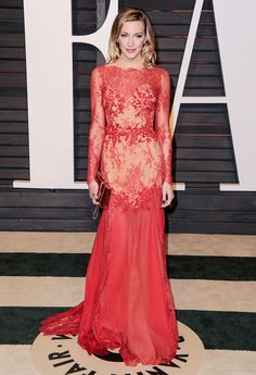 Katie Cassidy in a red long sleeve gown with lace bodice and godets at the 2015 Vanity Fair Oscar After-Party