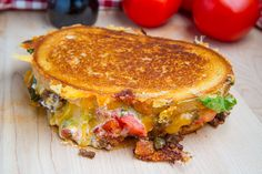 Taco Grilled Cheese--gooey and messy with salsa and guac!  Great to use up the left over meat.