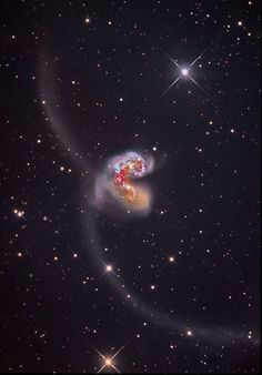 The Antennae Some 60 million light-years away in the southerly constellation Corvus, two large galaxies collided. But the stars in the two galaxies cataloged as NGC 4038 and NGC 4039 don't collide in the course of the ponderous, billion year or so. Space Planets, Space And Astronomy, Hubble Space, Space Telescope, Space Shuttle, Carl Sagan Cosmos, Space Photos, Space Images, Cs Lewis