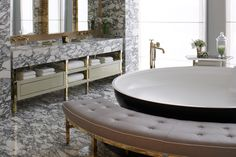 Bathtub & rounded seating place! David Collins Bathroom