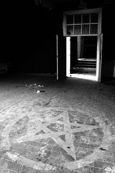Dark attic in an abandoned asylum. I dunno, looks like a setup pic to me. It keeps making the rounds on pintrest but I think it's BS.
