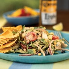 Chipotle Chicken Taco Salad~ Serve a zesty chicken taco salad drizzled with a chipotle chile, cumin, and cilantro dressing. The smokiness of the chipotle brings out the rich flavors of the roasted chicken breast     (actually a Cooking Light recipe.. but you wouldn't know it by looking at it!)