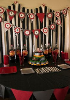 disney cars party - simple backdrop. black & white streamers, with birthday banner stretched across