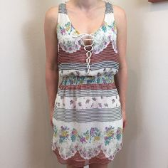 1 hr SALE Free People floral lace down dress Ties down front. Great material like FP always is. Worn maybe twice. Too small for me. Fits small to medium. Tags    Free people lululemon San Lorenzo kaikini boys + arrows band of gypsies acacia swim sexy bikinis Aztec lace boho Free People Dresses Mini