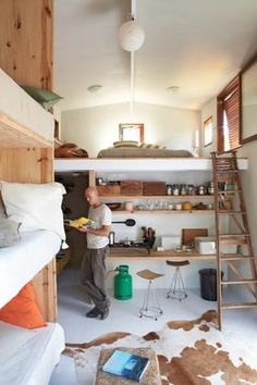 Cool, raw studio from House and Leisure.  Love the triple bunk. Then  again should also be easy to manage!