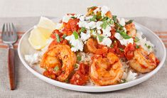 in the kitchen with stefano faita skillet shrimp with feta and tomato served over rice, drizzled with lemon juice and sprinkled with feta and mint Shellfish Recipes, Shrimp Recipes, Salad Recipes, Yummy Recipes, Yummy Food, Rhubarb Bbq Sauce, Bacon Mashed Potatoes, Grilled Sardines, Chicken Broccoli Pasta