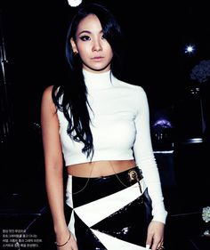2ne1 CL ... Love the chain coming from her top ... Classy sexy