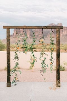 Arbor Decor for Any Theme Geometric desert wedding arbor with hanging greenery and color-coordinated flowers scattered throughout.Geometric desert wedding arbor with hanging greenery and color-coordinated flowers scattered throughout. Wedding Ceremony Ideas, Ceremony Backdrop, Wedding Trends, Wedding Arches, Backdrop Wedding, Backdrop Ideas, Wedding Draping, Photo Backdrops, Modest Wedding