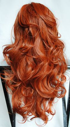 Red long wavy hair style.