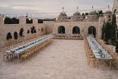 Outdoor Reception Festoon Lights U Table Greenery Foliage Candles Decor Puglia Wedding MIKI Studios #OutdoorWedding #WeddingReception #FestoonLights #UTable #GreeneryWedding #FoliageWedding #WeddingCandles #WeddingDecor #Wedding