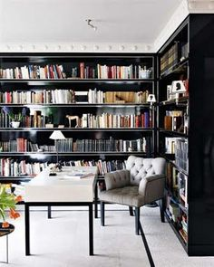 I am dreaming about turning my dining room into a food/book haven.  Totally doable with Ikea shelving.