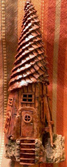 Front Spiral roof house cottonwood bark carving by N. Minske