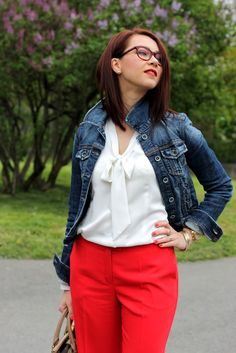 Red trousers, white shirt, denim jacket, red glasses