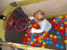 play pen turned ball pit, complete with bball hoop.