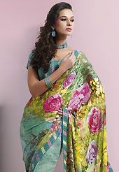 Try out this year top trend, glowing, bold and natural collection. This yellow and sea green brasso faux georgette saree is nicely designed with floral print, lace and patch work. Saree gives you a singular and dissimilar look. Matching sea green blouse is available. Slight color variations are possible due to differing screen and photograph resolution.