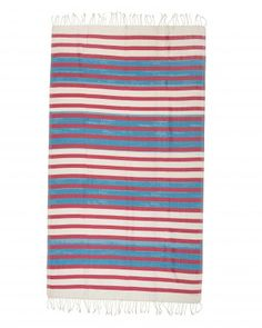 This limited edition jacquard stripe towel is generously sized and soft in hand. Its bold colours makes this a unique and all purpose accessory. Made out of 100% cotton, this can be used as a beach towel, beach mat, sarong or cover up. Available in 4 colour combinations.