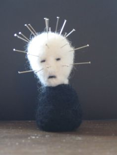 """I have such sights to show you! Well actually just this one. This felted wool pin-head cushion will keep yours pins neat and accessible. Can also be used to keep you company on your journey to hell.     Approximately 3"""" tall."""