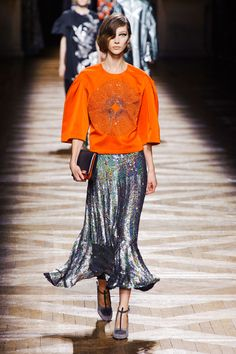 """Stunning and Dries Van Noten evening ensemble -- I really like combing orange w/silver and this silver trumpt skirt is a """"looker""""."""
